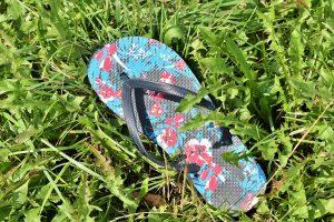 a blue flowery flip flop